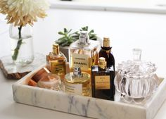 marble tray with fragrance bottles