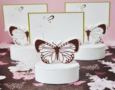 Butterfly Wedding Place Card Holder & Favor Box Set includes 12 place card favor boxes.  Each white wooden box features a cutout of a butterfly, which acts as a place card holder. The designer place cards match the theme.