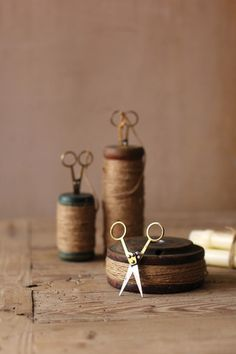 Kalalou Wooden Spools With Jute Twine And Scissors - Set Of 3 - Colorful and practical wood and metal spools come in a set of three pre-wrapped in jute twine and accompanied by sharp little scissors for cutting just the right length. Great for crafters or serial gift wrappers! Size and shape of spools will always vary.