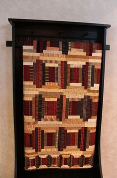 I love this little shelf to hang a quilt on!