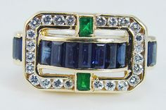 This wonderful estate band ring is finely crafted in solid 18K Yellow Gold and set with genuine Earth mined gemstones. Thirteen channel set Sapphires total 1.04 carats, two Emeralds total. 24 carat, and twenty four round brilliant cut diamonds total. 72 carat of VS2 clarity and H color.   eBay!