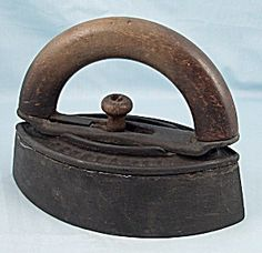My gramma had one of these iron with wood handle cast iron based irons that she heated on the wood-burning cook stove to do her ironing. AND that was when EVERY thing had to be ironed!! Plus, she was a farm wife: gathered and sold eggs, churned and sold butter, kept the subsistence garden for canning the family's winter food supply and did all the cooking from scratch. Can you imagine?