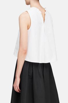 The refined silhouettes of Atlantique Ascoli take inspiration from the Paris-born designer's personal collection of Victorian blouses as well as women such as Charlotte Perriand, Diana Vreeland, and Martha Graham. Made in France of crisp, richly textured cotton piqué, this ruffled-neck blouse has a swingy shape. The split back is detailed with an inverted pleat that accentuates the relaxed fit.