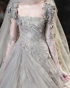 Arya's silver/ice dress inspiration (Winterfell crypt dreams).  Inspiration only--dress in the story is more era-appropriate and has shoulder to hem snowflake overlay made of silver thread
