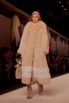 Lindsey Wixson in a fur great coat at Fendi AW15 MFW. See more here: http://www.dazeddigital.com/fashion/article/23860/1/fendi-aw15