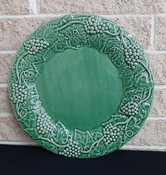 Bordallo Pinheiro 14 Inch Round Platter /Chop Plate - Green with Embossed Grapes and Leaves - Made in Portugal - Large Serving Plate by ClassyVintageGlass on Etsy Vintage Dinnerware, Hurricane Lamps, Faux Stained Glass, Green Grapes, Light Reflection, Blue Roses, Serving Plates, Ceramic Plates, Leaf Design