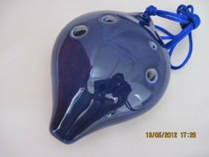 6 Holes Ceramic Pear Shape Ocarina - Good gift item & also a piece of instrument Dark Blue Color by Utopia. $28.95. Sounding great -- on Alto C tone. Cute Peal Shape Ceramic  -- Dark Blue Color. Width: 3  1/8 inch  .. Thick: 1.5 inch (Height) .. Height: 4.25 inch. Good for gift item and is also a piece of music instrument. Size: Weight: 130 g (4.6 Oz). 6 Holes Ceramic Ocarina Pear Shape Dark Navy Blue Color. Alto C Key, and easy to start with and play.  Sounding q...