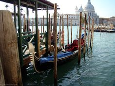 A Docked Deluxe Gondola in the Grand Canal across from Punta Dogana and Chiesa delia Salute