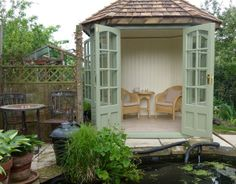 A summerhouse with wooden roof tiles.