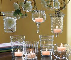 HANGING  CANDLE  VOTIVES ...  a variation on the mason jar theme would be to make wire hangers for decorative clear or iridescent vases (make sure the vase has a small LIP or RIM).  To keep the votive candle in place, you may want to fill the bottom of the vase with glass pebbles.