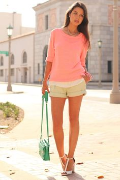 coral sweater, beige shorts, white heels and turquoise purse