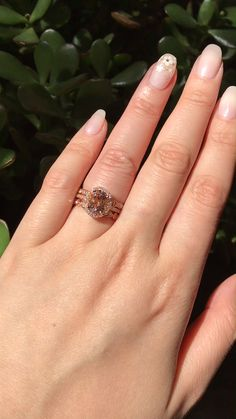 Halo Ring Bridal Set of an Oval Morganite Engagement Ring in 14k Rose Gold Halo Diamond Ring Setting pairs gorgeously with a Scalloped Diamond Band(top) an Bezel Scalloped Diamond Band(below). Check out more of our Morganite Bridal Ring Set Collection by La More Design here!