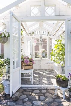 - Beautiful white greenhouses with lush green plants, leaves and leafy florals | Dream garden | Gardening inspiration | Greenhouse and conservatory ideas | By jewellery label AU REVOIR LES FILLES | Shop beautiful stacking rings and fine necklaces at www.aurevoirlesfilles.com
