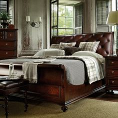Leather sleigh bed..