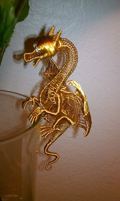 Baby Orion, this little guy is handmade. Wire Crafts, Jewelry Crafts, Handmade Jewelry, Wire Wrapped Jewelry, Metal Jewelry, Dragons, Wire Art Sculpture, Sculptures, Dragon Jewelry