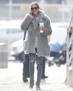 Olivia Palermoin an oversized faux fur coat and ripped skinny jeans. Starbucks in hand so that outfit is complete