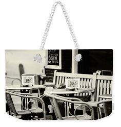 Jenny Rainbow Fine Art Photography Weekender Tote Bag featuring the photograph Street Cafe In Amsterdam. Black And White by Jenny Rainbow