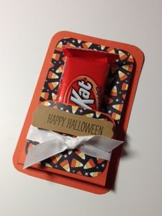 Halloween treat holder - I would use valentine paper and give out as valentine cards at school.
