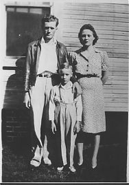 Elvis and his parents look with pride toward the photographer, circa 1942.