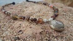 Items similar to Agat Gemstone and silver Beads Necklace with Crazy Lace Silver Pendant, Spiritual jewelry, Charm, one of a kind, brown colors on Etsy Silver Bead Necklace, Silver Beads, Silver Jewelry, Unique Jewelry, Spiritual Jewelry, Agate, Sculpting, Brown Colors, Healing