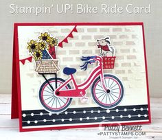 Bike Ride 4th of July patrioit card idea featuring brick embossing paste background, die cut doggie, sunflowers, and baskets. Card by Patty Bennett at pattystamps.com