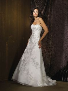 Exquisite Embroidery Vintage Dress with Sweetheart Neckline. A line shilhouette gown, vintage. Sweetheart neckline, glamorous embroidery bust. Flower embroidery work accented tulle overlay, which spreads to be chapel length train.  Dream embroidery dress for brides and brides-to-be.