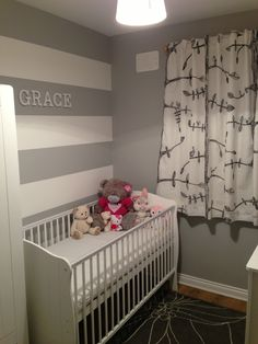 Grey and White Striped accent wall in nursery