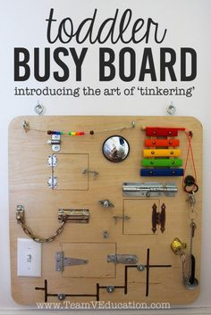 DIY Toddler Busy Board with peek-a-boo doors, latches, locks, and more! DIY Toddler Busy Board with peek-a-boo doors, Toddler Fun, Toddler Toys, Toddler Playroom, Toddler Gifts, Diy Kid Gifts, Toddler Slide, Toddler Playground, Diy Busy Board, Kids Board