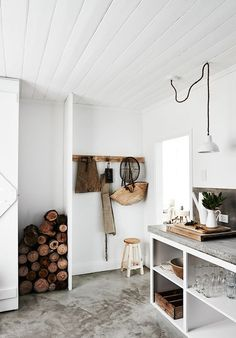 The most beautiful way to keep wood in a neat stacked way... Love the White and the wood combination