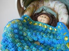 This Bobble Blanket for Infant Carrier is a great gift every new mom needs. Protect your baby from the cold and wind with this easy crochet pattern. Baby will stay sound asleep while kept nice and warm under the blanket.