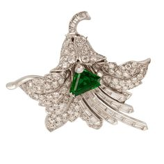 Paul Flato Emerald Diamond Platinum Pin Pendant | See more rare vintage Brooches at https://www.1stdibs.com/jewelry/brooches/brooches