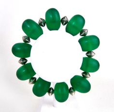 Green holiday bracelet of vintage glass beads and by MadMamaMiller