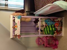 1x2's, bungee cord, and some paint= super storage for lil's stuffed animals!