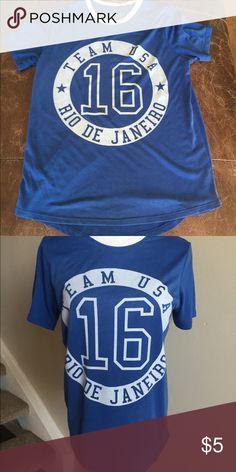 Team USA Blue T-shirt Soft blue Team USA Rio De Janeiro t-shirt. Celebrate the 2016 Summer Olympics and future Olympics with this comfy shirt! Size medium. Tops Tees - Short Sleeve