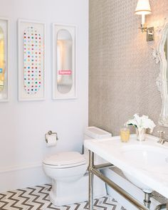 Damien Hirst skateboards framed as art in a bathroom designed by Susan Greenleaf #bathroom #homedecor #interiordesign
