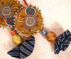 Flower motifs of kalamkari are lined with kinari and jazzed up with gold thread beads