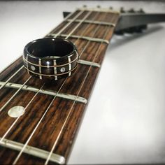 "2,146 Likes, 177 Comments - Jared Lamb (@jareds.ring.shop) on Instagram: ""Check out these new fretboard rings  available in Ebony and Rosewood, with gold or silver string…"""