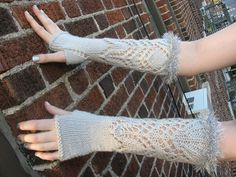 Knit from the elbow to the hand, these easy lace mitts are a great beginner lace project. Two simple lace patterns flow over the wrist and the hand is knit in stockinette with an easy yarn over increased thumb gusset. Optional glittery trim is picked up and knit from the cast on edge for a little bit of glitz and glamour. Enjoy!