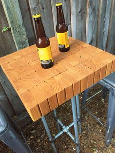 A bar table can provide a cool spot to have a drink without taking up too much room in a small space. This DIY outdoor bar table is made of 2-by-4s that are cut into same-size blocks and glued together, then attached to a stand made of metal pipes and fittings.