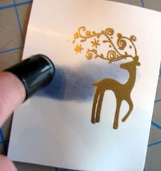 I inked the reindeer with gold ink and stamped, and then sprinkled on gold embossing powder and set it with the heat tool.