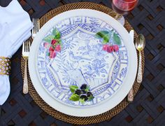 Gien handpainted Oiseau Bleu dinner plate & white charger on Calaisio placemat, Riedel Champagne Glass, white napkin & Oscar de la Renta Gardenia napkin ring #Calaisio #Gien #Oscardelarenta
