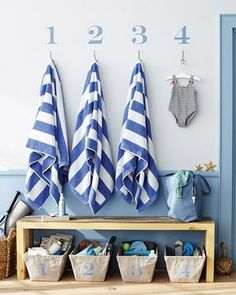great for hanging towels after pool time, with bins under for people to place their belongings so they don't end up drenched