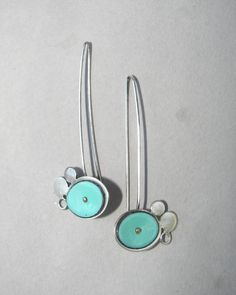 My sterling silver and turquoise enamel dangling architectural earrings add a fun pop of color to your day. The handmade abstract flower earrings measure 7/8 inch wide and 2 inches long from the top of the dramatic ear wire. The architectural earrings, shown in turquoise, are also available in horizon blue, cobalt blue, lime green, mellow yellow, and orange (see the color chart included with the listing).  Thank you for viewing my long, sterling-silver and turquoise enamel abstract flower…