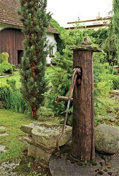 Outdoor Water Well / A rustic delight. Country Farm, Country Life, Old Water Pumps, Wooden Arbor, Professional Landscaping, Water Features In The Garden, Country Scenes, Water Well, Garden Fountains