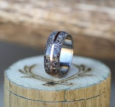 Handcrafted wedding ring with elk antler inlay. Crafted by the artisans at Staghead Designs.