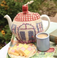 Pretty much as English as it gets! A teapot, cuppa tea and Battenburg cake! But it's the knitted tea cozy complete with yarn chimney smoke that charms me most.