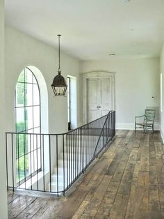 {Home Tour} Fantasy French Country Home in Houston Luxurious mansion in Houston with rustic wood floors, lantern, and iron railing on stone staircase. Wrought Iron Stairs, Iron Stair Railing, Staircase Railings, Iron Staircase, Banisters, Iron Handrails, Staircases, Style At Home, Rustic Wood Floors