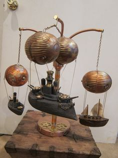 Aerial Armada  Steampunk Airship Mobile by WillRockwell on Etsy, $800.00. I think these used to be toilet bowl floats. Great stuff!