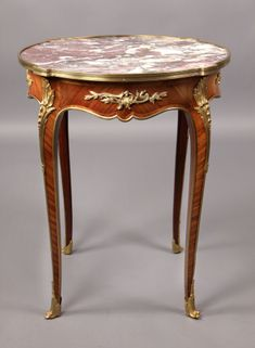 A Late 19th Century Louis XV Style Gilt Bronze Mounted Marble Top Lamp Table