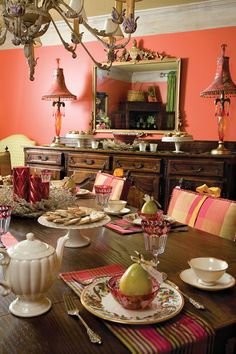 The holidays mean joyful get-togethers and festive gatherings. Create a cheerful table by lighting red candles of varying heights for an interesting centerpiece, and serve guests with china decorated with the fruits of the season